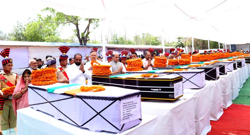 Union Home Minister Rajnath Singh pays tributes to the martyred CRPF personnel in Raipur on April 25, 2017. Also seen Chhattisgarh Chief Minister Dr. Raman Singh and the Minister of State for ... - Rajnath Singh and Raman Singh