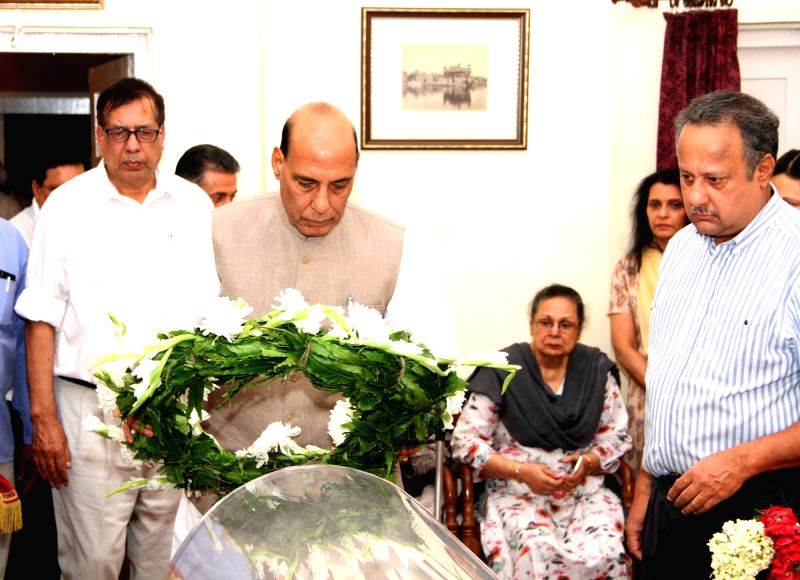 Union Home Minister Rajnath Singh pays tributes at mortal remains of former Director General of Police (DGP) of Punjab K.P.S. Gill in New Delhi on May 27, 2017. - Rajnath Singh