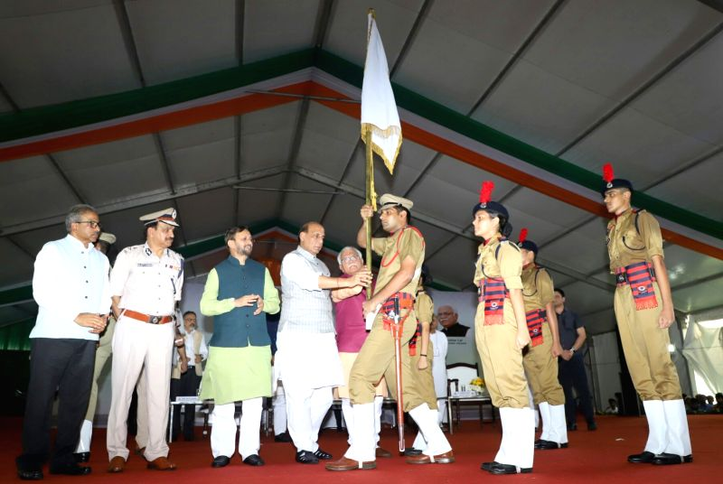 Union Home Minister Rajnath Singh presents the colours to the Student Police Cadet (SPC) Haryana Platoon Commander along with Haryana Chief Minister Manohar Lal Khattar and Union Human ... - Rajnath Singh and Manohar Lal Khattar