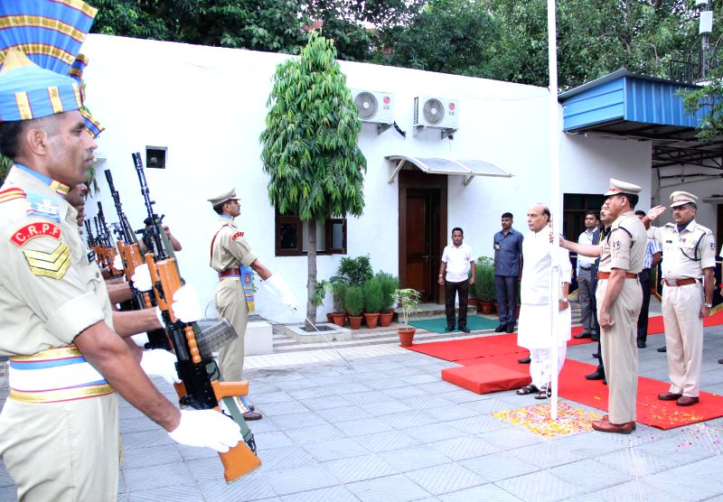 Union Home Minister Rajnath Singh receives the Guard of Honour after hoisting the National Flag at his official residence, on the occasion of 68th Independence Day, in New Delhi on August 15, 2014.