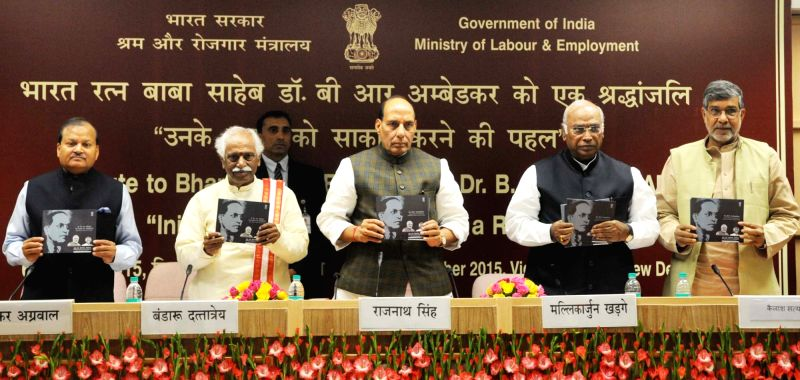 Union Home Minister, Rajnath Singh releases a booklet on Dr B R Ambedkar on his 60th Mahaparinirvan Diwas, in New Delhi on Dec 6, 2015. Also seen Union Minister of State for Labour and ... - Rajnath Singh