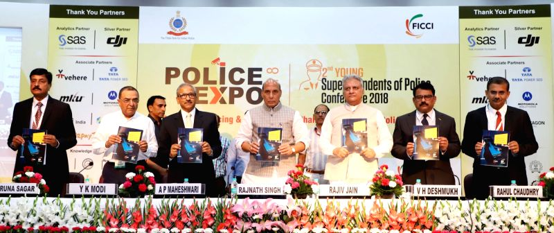 "Union Home Minister Rajnath Singh releases a report on ""Predictive Policing and way forward"" along with Intelligence Bureau Director Rajiv Jain and Bureau of Police Research and ... - Rajnath Singh and Rajiv Jain"