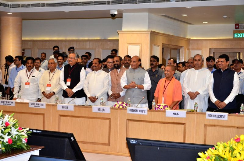 Union Home Minister Rajnath Singh with Bihar Chief Minister Nitish Kumar, Jharkhand Chief Minister Raghubar Das, Chattisgarh Chief Minister Raman Singh, Uttar Pradesh Chief Minister Yogi ... - Rajnath Singh, Nitish Kumar and Raman Singh