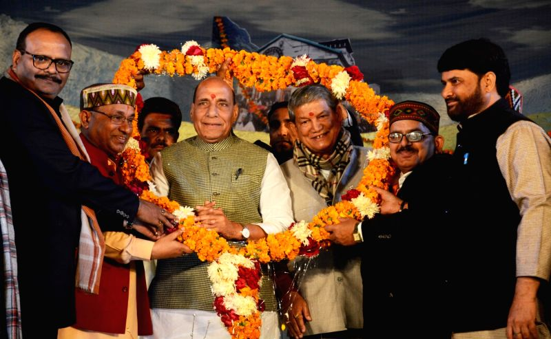 Union Home Minister Rajnath Singh with Congress leader Harish Rawat during a programme in Lucknow on Jan 20, 2018. - Rajnath Singh