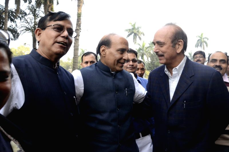 Union Home Minister Rajnath Singh with CPI(M) leader Mohd Salim and Congress leader Ghulam Nabi Azad during the winter session of the Parliament in New Delhi, on Dec 1, 2015.
