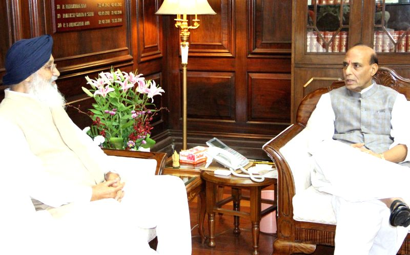 Union Home Minister Rajnath Singh with Punjab Chief Minister Parkash Singh Badal during a meeting in New Delhi on July 10, 2014.