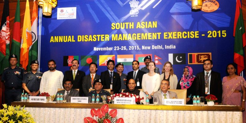Union Home Minister Rajnath Singh with the medal winner officers of NDRF, at the concluding session of the first South Asia Annual Disaster Management Exercise (SAADMEx)-2015, in New Delhi on Nov 26, ... - Rajnath Singh