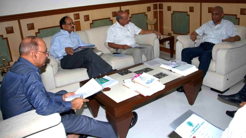 Union Home Secretary Anil Goswami during a meeting with Andhra Pradesh Governor E. S. L. Narasimhan regarding bifurcation of the state in Hyderabad on May 12, 2014.