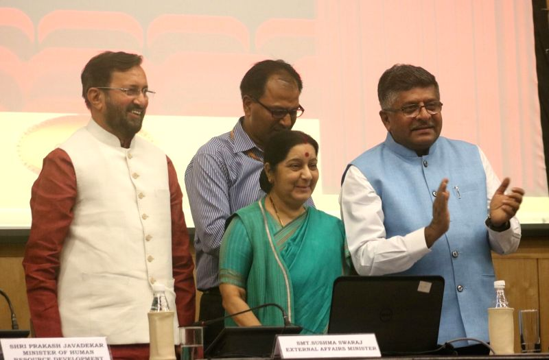 Union HRD Minister Prakash Javadekar, External Affairs Minister Sushma Swaraj and Union Information Technology Minister Ravi Shankar Prasad during a programme organised to launch ... - Prakash Javadekar and Sushma Swaraj