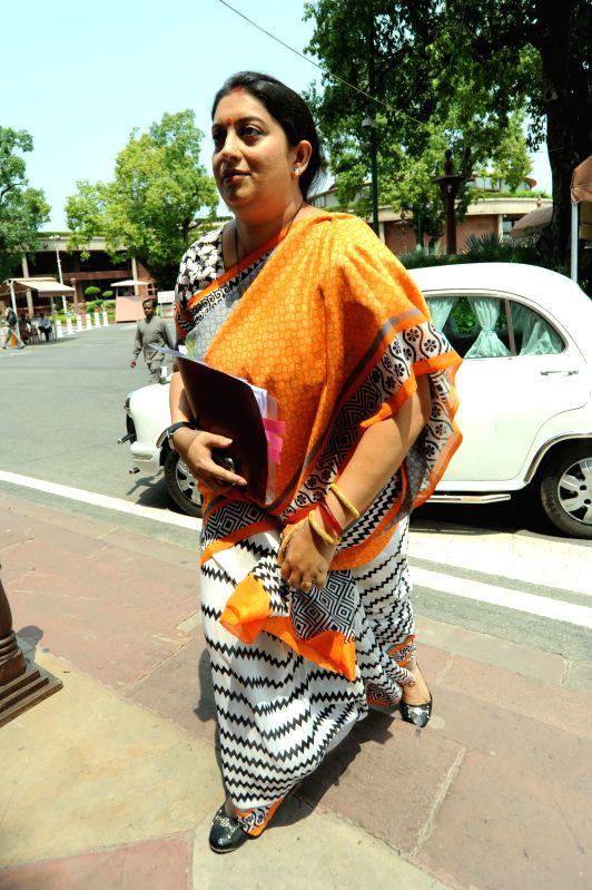 Union HRD Minister Smriti Z Irani arrives at the Parliament in New Delhi on Aug 12, 2014. - Smriti Z Irani