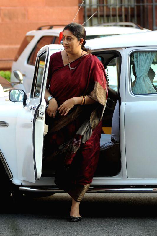 Union HRD Minister Smriti Z Irani arrives at the Parliament in New Delhi on Aug 13, 2014. - Smriti Z Irani