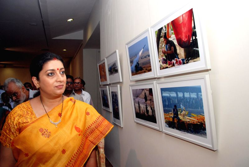 Union HRD Minister Smriti Z Irani during inauguration of `The Big Picture` - a photo exhibition organised by All india Working News Cameraman's Association at Lalit Kala Academy in New Delhi on Aug .. - Smriti Z Irani