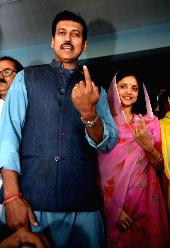 Union Information and Broadcasting Minister Rajyavardhan Singh Rathore and his wife Gayathri Rathore show their inked fingers after casting their votes for Rajasthan Assembly elections in ... - Rajyavardhan Singh Rathore