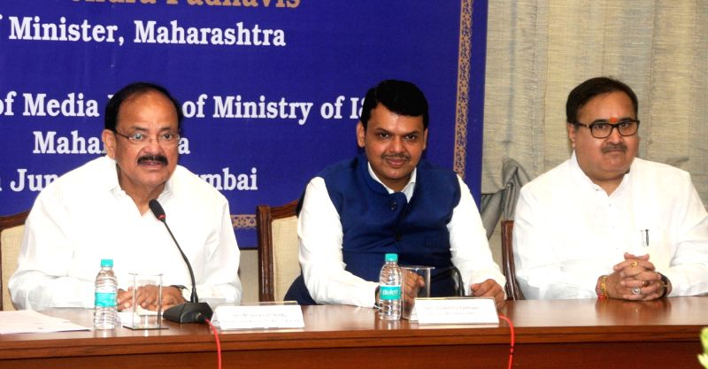 Union Information and Broadcasting Minister M. Venkaiah Naidu along with Maharashtra Chief Minister Devendra Fadnavis holds a review meeting with officials of Information and Broadcasting ... - M. Venkaiah Naidu