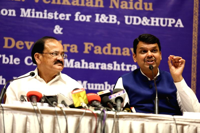 Union Information and Broadcasting Minister M. Venkaiah Naidu and Maharashtra Chief Minister Devendra Fadnavis during a joint press conference in in Mumbai on June 6, 2017. - M. Venkaiah Naidu