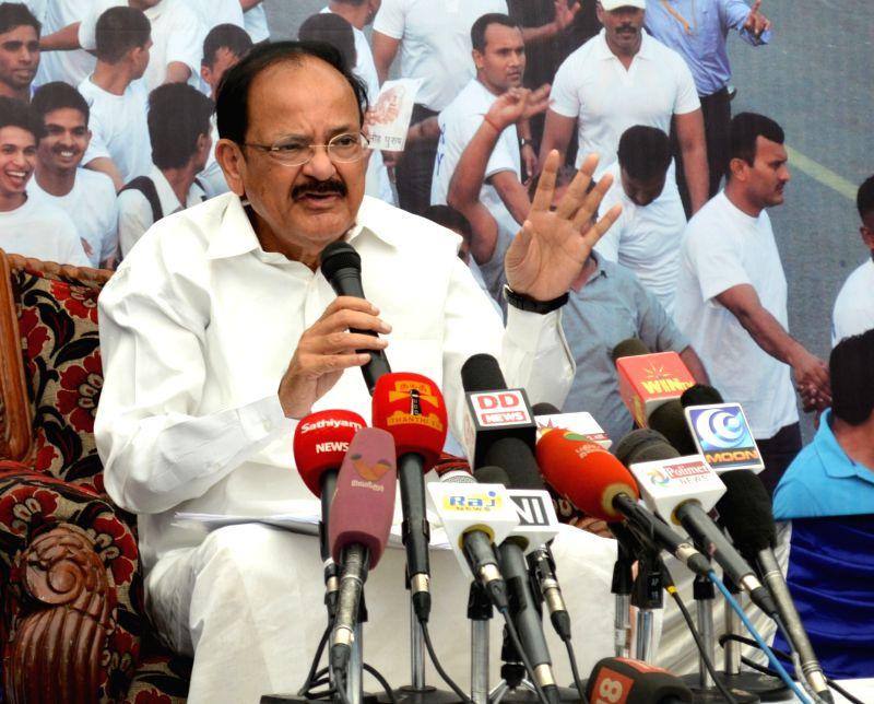 "Union Information and Broadcasting Minister M. Venkaiah Naidu interacts with the media after inaugurating the ""Saath Hai Vishwaas Hai, Ho Raha Vikas Hai"" exhibition in Chennai, Tamil ... - M. Venkaiah Naidu"