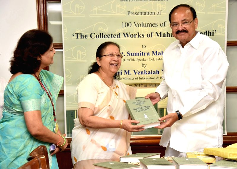 Union Information and Broadcasting Minister M. Venkaiah Naidu presents the 100 Volumes of 'The Collected Works of Mahatma Gandhi' to the Lok Sabha Speaker Sumitra Mahajan, for ... - M. Venkaiah Naidu and Sumitra Mahajan