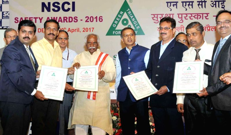 Union Labour and Employment Minister Bandaru Dattatreya presents the NSCI Safety Awards 2016, during a programme in New Delhi on April 20, 2017. - Bandaru Dattatreya