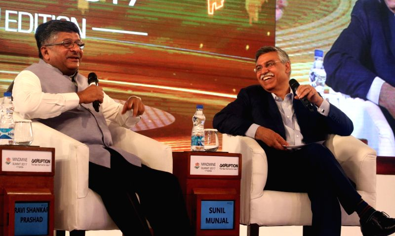 Union Law Minister Ravi Shankar Prasad and Hero MotoCorp Joint Managing Director Sunil Kant Munjal during Mindmine Summit 2017 in New Delhi, on April 21, 2017. - Ravi Shankar Prasad