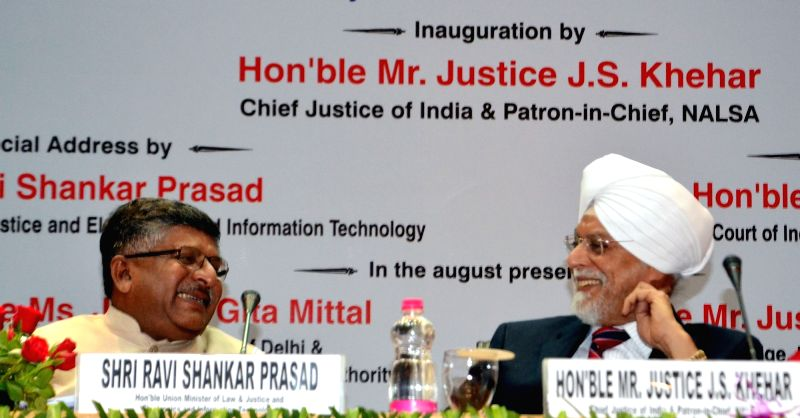 "Union Law Minister Ravi Shankar Prasad interacts with Chief Justice of India Justice Jagdish Singh Khehar during the National Meet of Para Legal Volunteers ""Soilders of Legal Services ... - Ravi Shankar Prasad and Jagdish Singh Khehar"