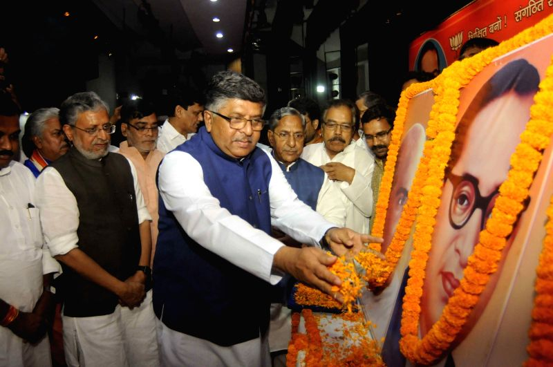 Union Law Minister Ravi Shankar Prasad pays tribute to Dalit icon Dr B.R. Ambedkar during a programme organised by BJP to celebrate Ambedkar Jayanti in Patna on April 13, 2018. Also seen Bihar ... - Ravi Shankar Prasad and Sushil Kumar Modi