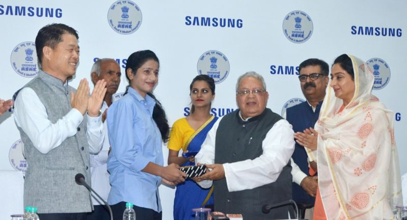 Union Micro, Small and Medium Enterprises Minister Kalraj Mishra, Samsung Southwest Asia President and CEO HC Hong and Union Minister for Food Processing Industries Harsimrat Kaur Badal at ... - Kalraj Mishra