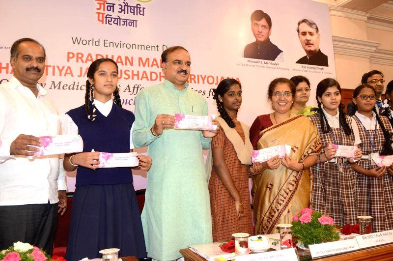 Union Minister Ananth Kumar, Adamya Chetana Founder Tejaswini Ananth Kumar and school students during the launch of Janaushadhi Suvidha Oxo-biodegradable sanitary napkins, organised on the ... - Ananth Kumar
