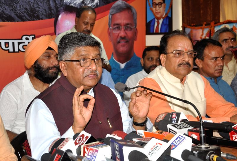 Union Minister and BJP leader Ravi Shankar Prasad addresses a press conference at the party office, in Dehradun on June 12, 2018.