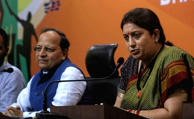 Union Minister and BJP leader Smriti Zubin Irani  and party leader Arun Singh during a press conference in New Delhi on May 22, 2017. - Smriti Zubin Irani and Arun Singh