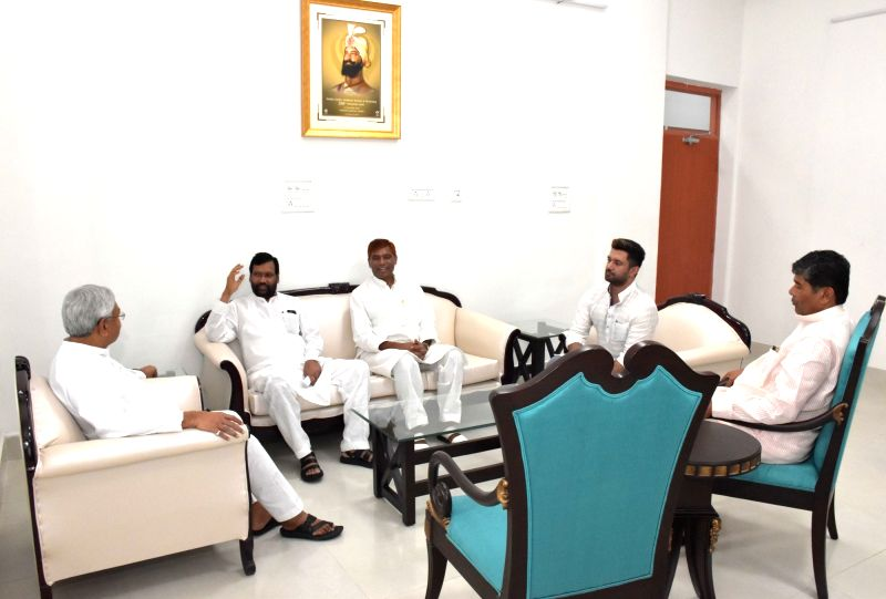 Union Minister and LJP Chief Ram Vilas Paswan accompanied by his son and party leader Chirag Paswan meet Bihar Chief Minister Nitish Kumar, in Patna on Aug 12, 2018. - Nitish Kumar