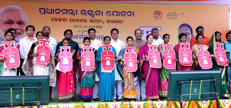 Union Minister Dharmendra Pradhan distributes the free LPG connections to poor women under Pradhan Mantri Ujjwala Yojna (PMUY), at a function, in Rayagada, Odisha on June 1, 2017.​ ... - Dharmendra Pradhan