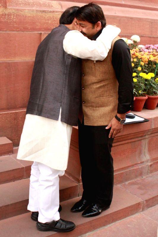 Union Minister Dr Mahesh Sharma with BJP MP Manoj Tiwari at the Parliament in New Delhi, on Dec 10, 2015. - Mahesh Sharma