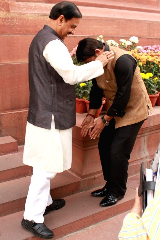 Union Minister Dr Mahesh Sharma with BJP MP Manoj Tiwari at the Parliament in New Delhi, on Dec 10, 2015. - D and Mahesh Sharma