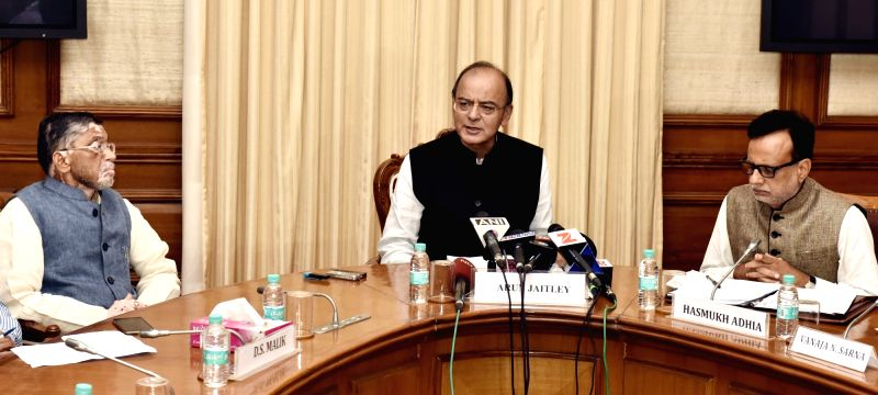Union Minister Finance Minister Arun Jaitley addresses a press conference, in New Delhi on July 17, 2017. Also seen MoS Finance Santosh Kumar Gangwar and Revenue Secretary Dr. Hasmukh ... - Finance Minister Arun Jaitley and Santosh Kumar Gangwar