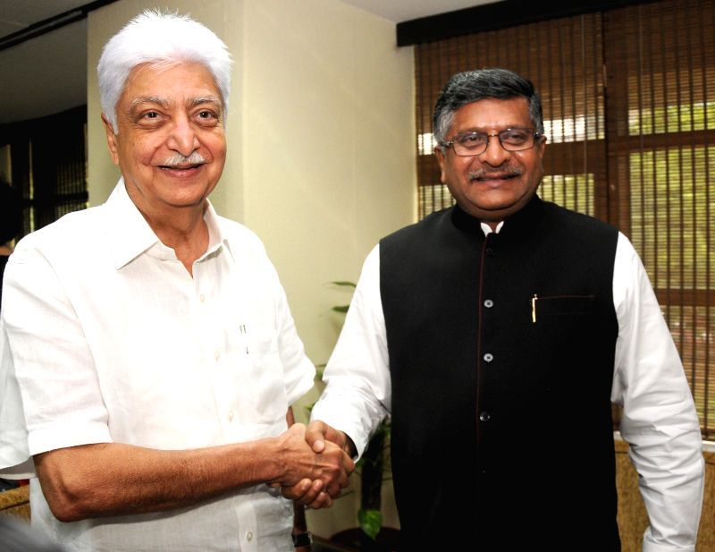 Union Minister foe Communications and Information Technology, and Law and Justice, Ravi Shankar Prasad during a meeting with Wipro Chairman Azim Premji in New Delhi on July 3, 2014.