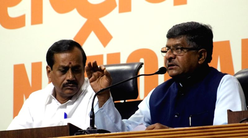 Union Minister for Communications and Information Technology Ravi Shankar Prasad addresses a press conference regarding violence in Kerala; in New Delhi, on May 21, 2016. Also seen BJP ...