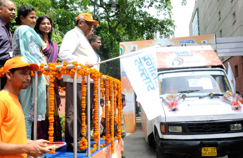 Union Minister for Communications and Information Technology Ravi Shankar Prasad flags off the Digital India Vans in New Delhi, on May 30, 2016.