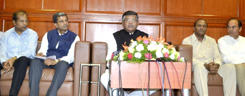 Union Minister for Communications & Information Technology Ravi Shankar Prasad addresses press, on the sidelines of the 'Heads of Circles Conference of Department of Posts', in ...