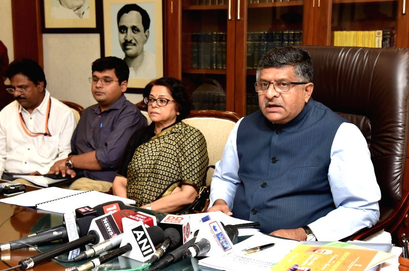 Union Minister for Electronics and Information Technology and Law and Justice Ravi Shankar Prasad addresses on the findings of a high-level committee that was set up to review the ...