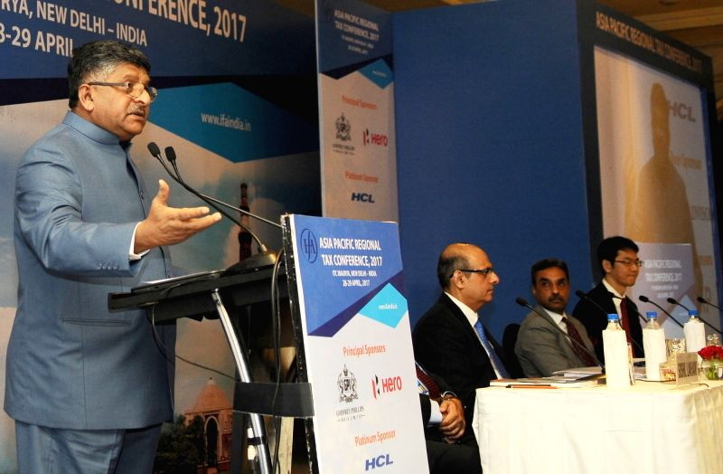 Union Minister for Electronics & Information Technology and Law & Justice Ravi Shankar Prasad addresses at the inauguration of the Asia Pacific Regional Tax Conference, organised ...