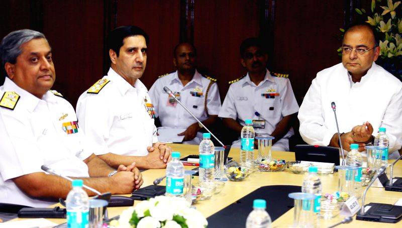 Union Minister for Finance, Corporate Affairs and Defence Arun Jaitley with the Navy officers during the Bi-annual Naval Commanders' Conference in New Delhi on June 24, 2014. - Arun Jaitley