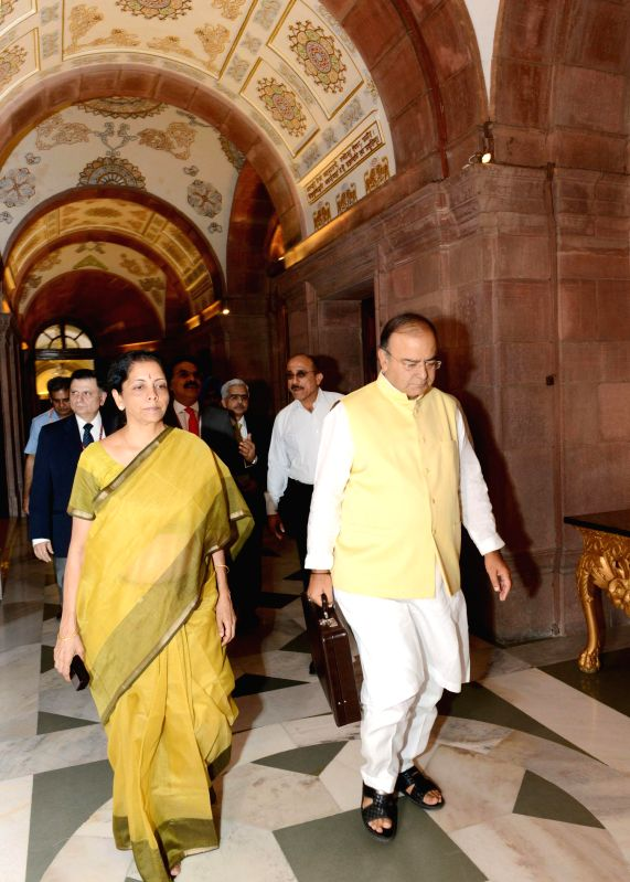 Union Minister for Finance, Corporate Affairs and Defence Arun Jaitley and MoS Commerce and Industry (Independent Charge), Finance and Corporate Affairs Nirmala Sitharaman arrive at Rashtrapati ... - Arun Jaitley
