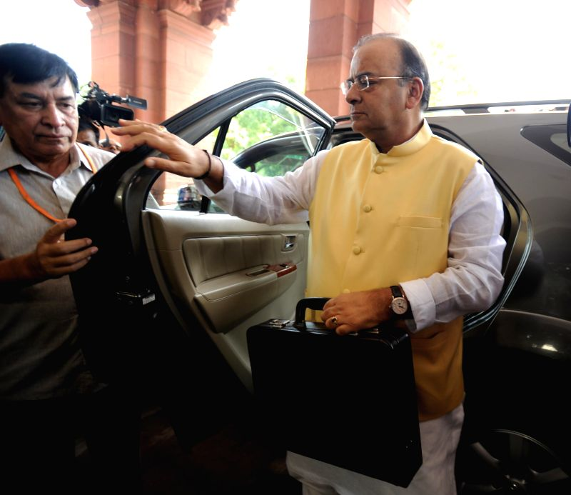Union Minister for Finance, Corporate Affairs and Defence Arun Jaitley arrives at the Parliament to present General Budget 2014-15 in New Delhi on July 10, 2014.