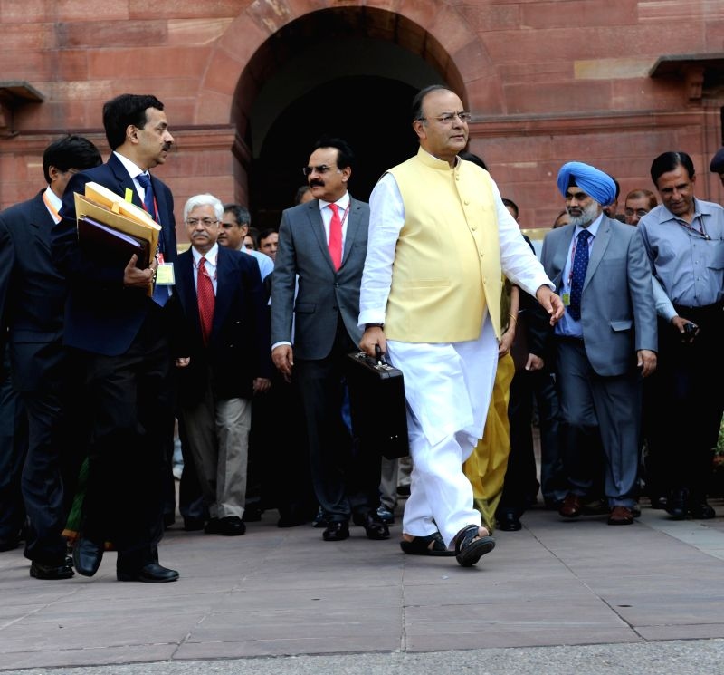 Union Minister for Finance, Corporate Affairs and Defence Arun Jaitley leaves for the Parliament from North Block to present General Budget 2014-15 in New Delhi on July 10, 2014.