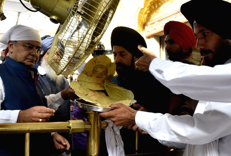 Union Minister for Finance, Corporate Affairs and Defence Arun Jaitley pays obeisance at the Golden Temple in Amritsar on Aug 18, 2014.