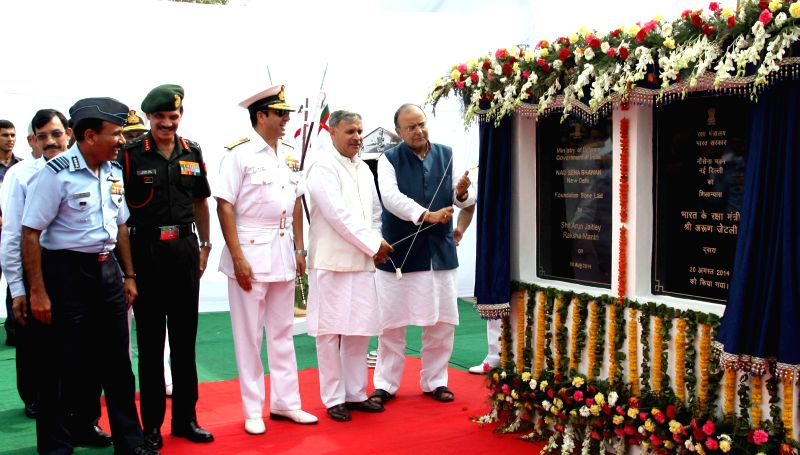 Union Minister for Finance, Corporate Affairs and Defence Arun Jaitley unveils the plaque to lay the foundation stone of Nau Sena Bhawan in New Delhi on August 20, 2014. Also seen MoS Planning ... - Inderjit Singh and Dalbir Singh
