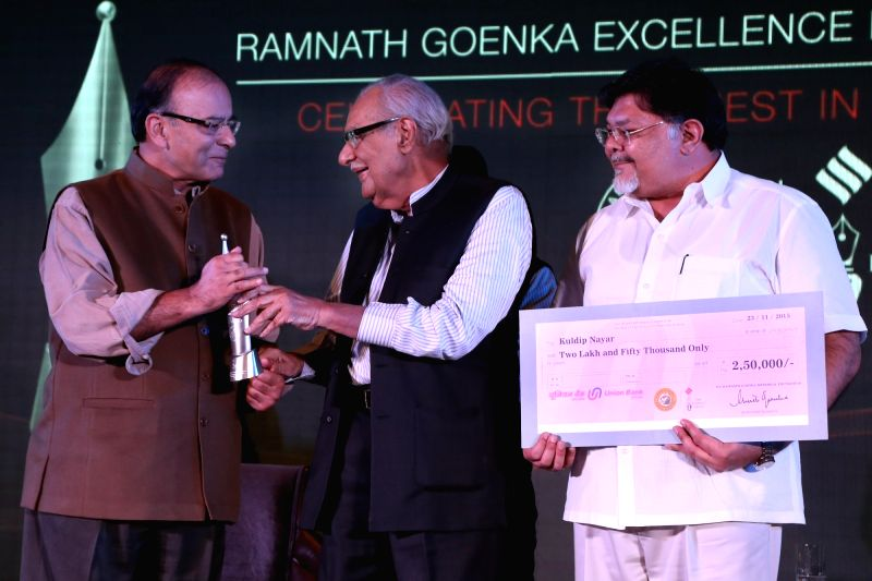 Union Minister for Finance, Corporate Affairs, and Information and Broadcasting Arun Jaitley presenting  the Ramnath Goenka Lifetime Achievement Award to Kuldip Nayar at the Ramnath Goenka ... - Arun Jaitley