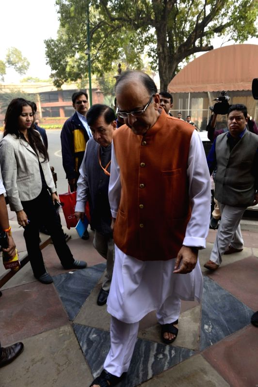 Union Minister for Finance, Corporate Affairs, and Information and Broadcasting Arun Jaitley arrives at the Parliament in New Delhi on Nov 30, 2015. - Arun Jaitley