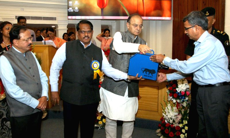 Union Minister for Finance, Corporate Affairs and Defence Arun Jaitley hands over the 'Preemptor' to the Additional Director IB PS Purohit, in New Delhi on May 1, 2017. Also seen Minister ... - Arun Jaitley