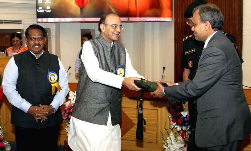 Union Minister for Finance, Corporate Affairs and Defence Arun Jaitley hands over the 'OTL-300' to the Commissioner of Police, Delhi Police Amulya Patnaik in New Delhi on May 1, 2017. Also ... - Arun Jaitley